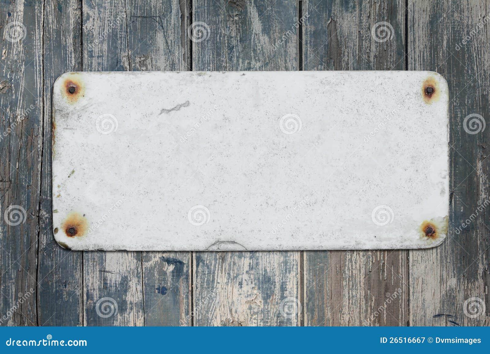 Gammal blank tecken och vägg