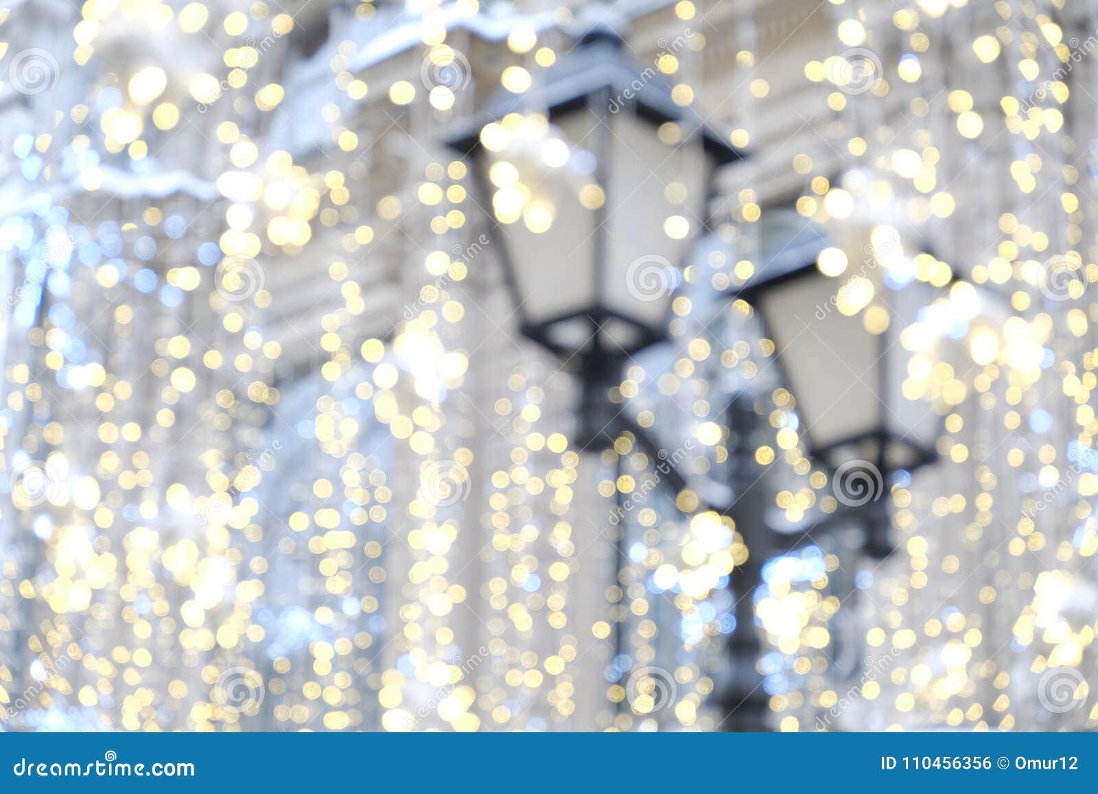 Gammal blured garnering för gatalampa och för julljus