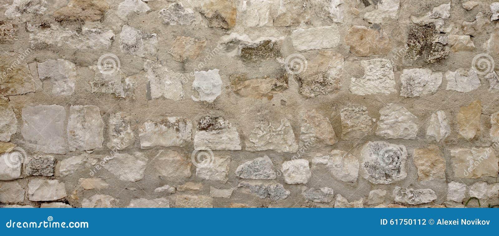 Gammal granitstenvägg med cementsömmen, stenhuggeriarbete breda Backgrou