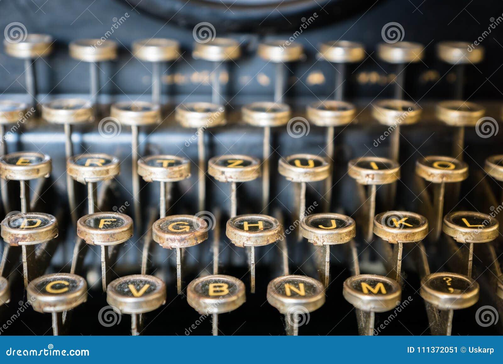 Gammal närbild för skrivmaskinstangentbord