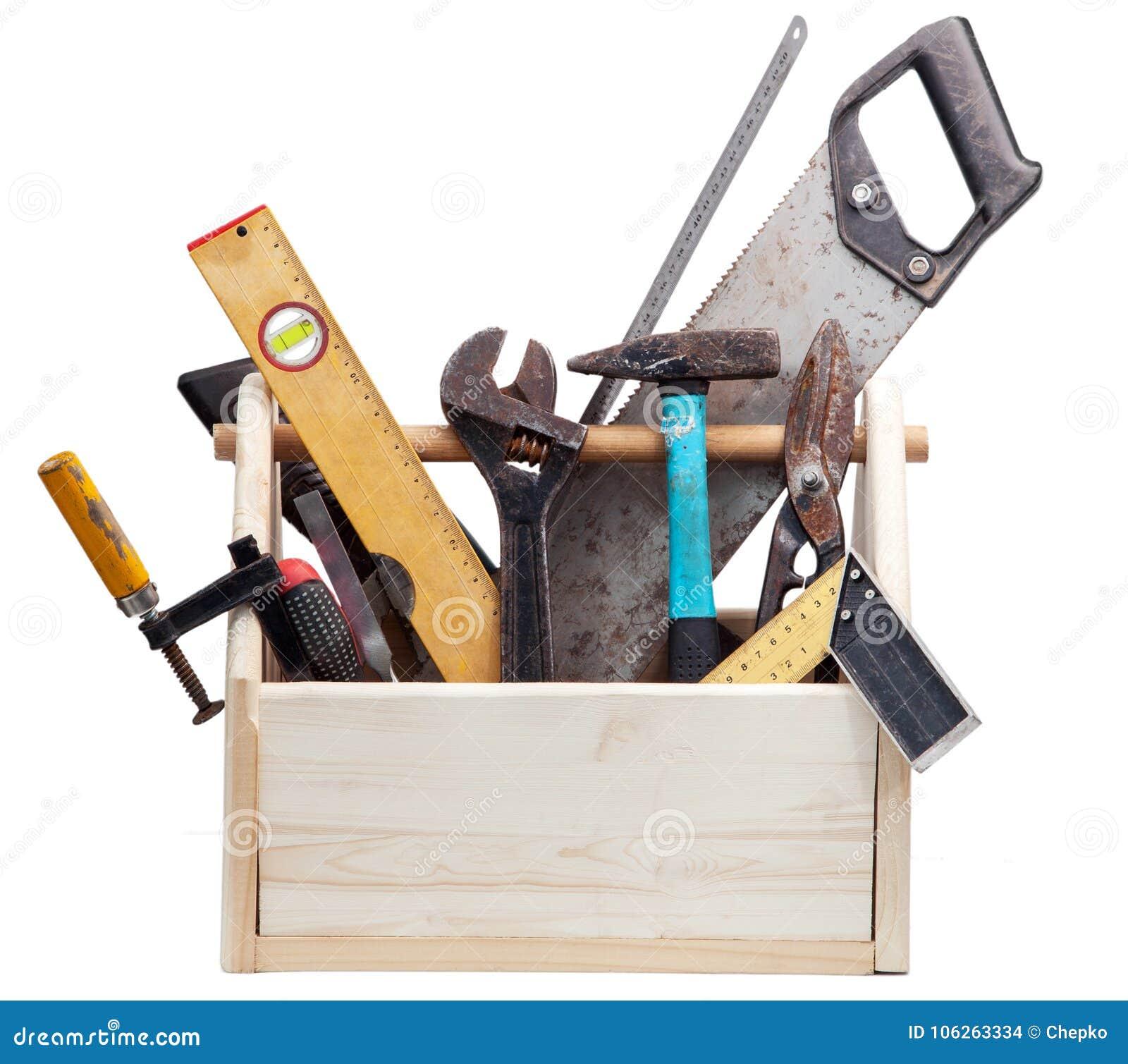 Gammal snickareWooden toolbox med hjälpmedel som isoleras på vit