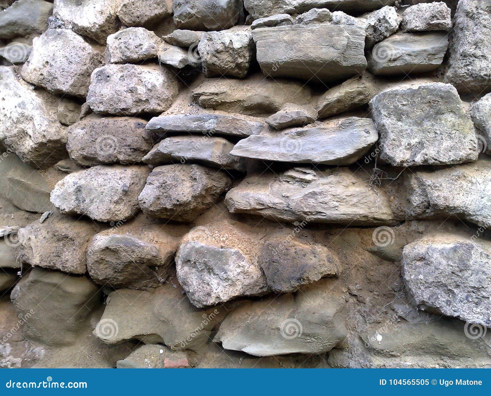 Gammal stenvägg i Italien