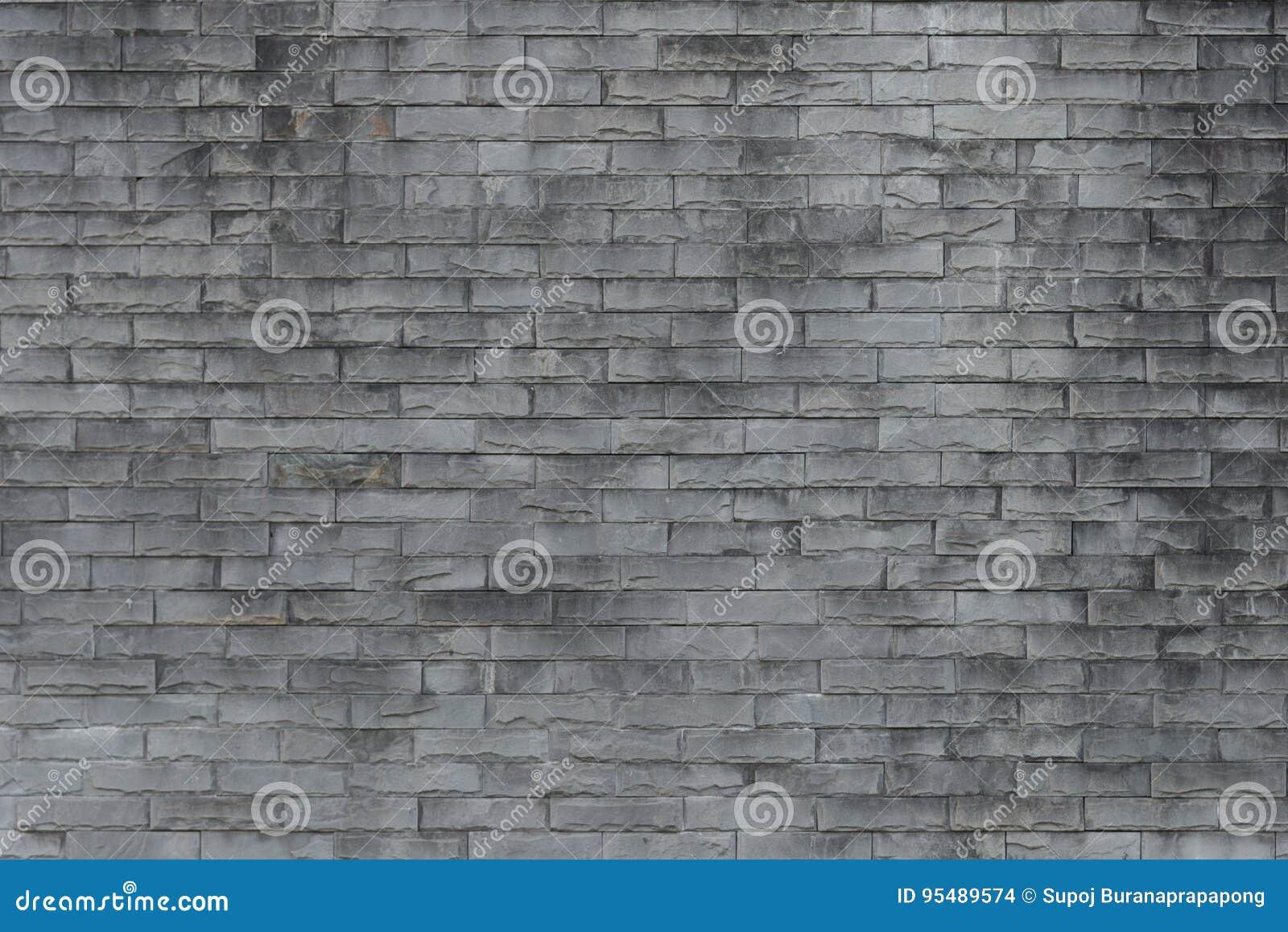 Gammal vägg för bakgrundstegelsten Grunge textur Svart tapet mörkt