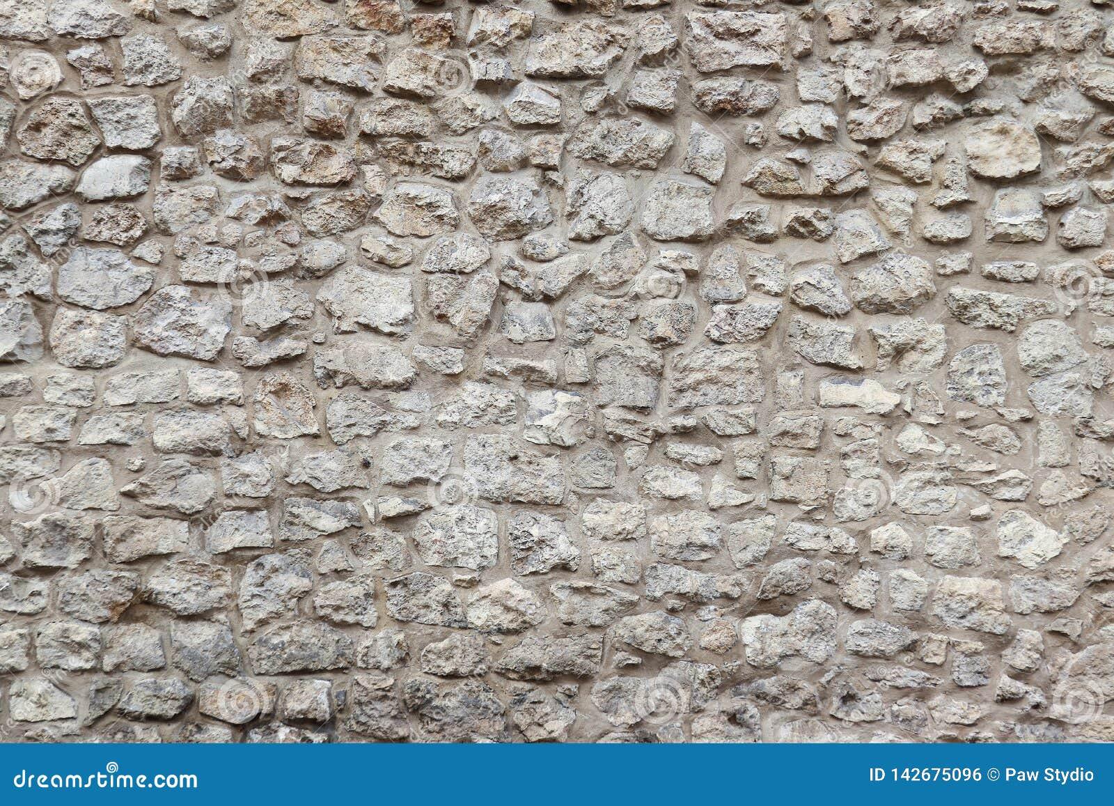 Gammalt stena väggen och cement detaljerad verklig sten för bakgrund mycket Krakow stenvägg