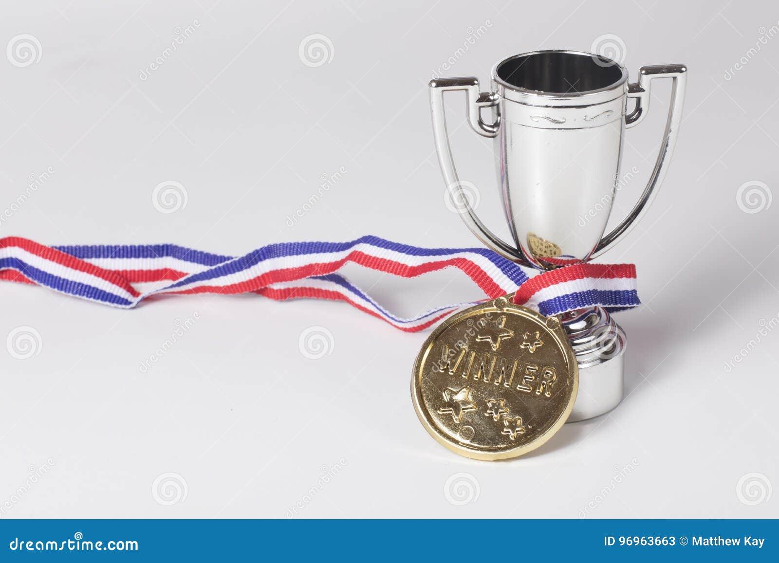 Ganador de medalla de oro y trofeo de la plata
