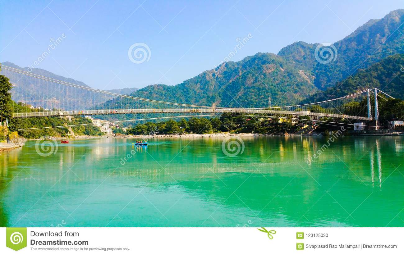 Scenic view of Ganges river flowing through mountains.