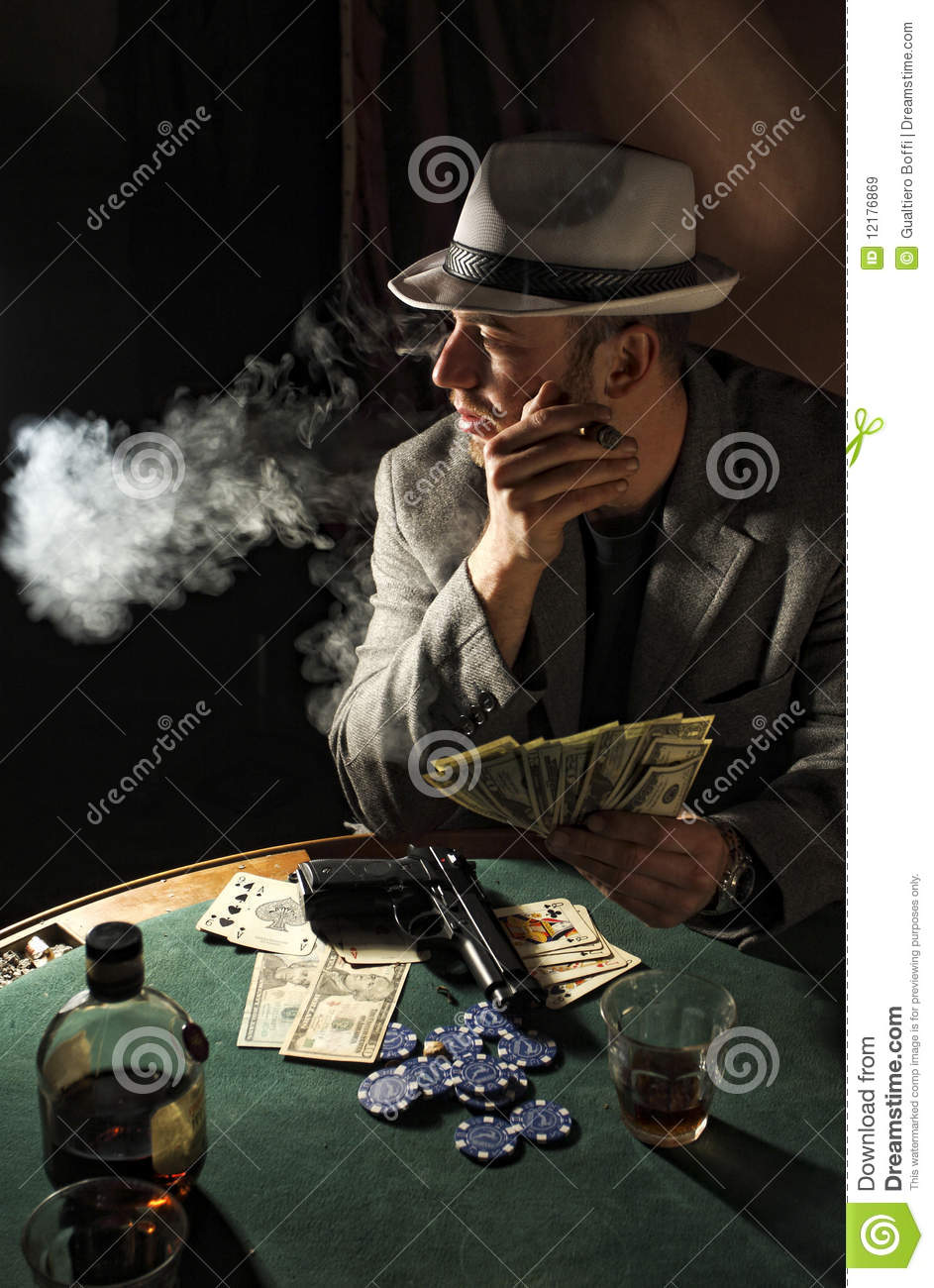 gangster smoking and play poker royalty free stock images