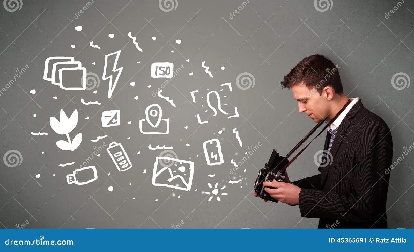 Garçon de photographe capturant les icônes et les symboles blancs de photographie