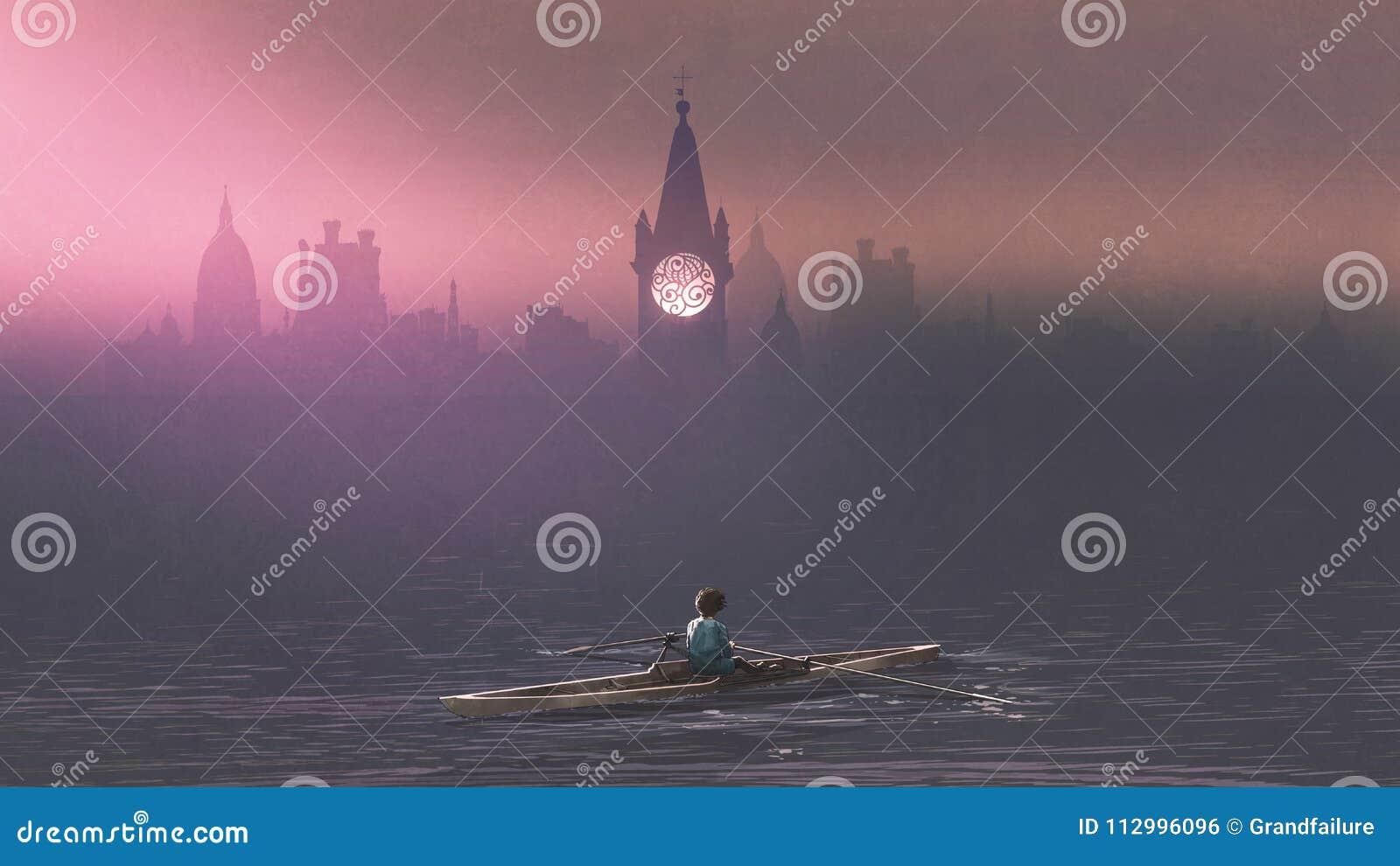 Garçon ramant un bateau en mer