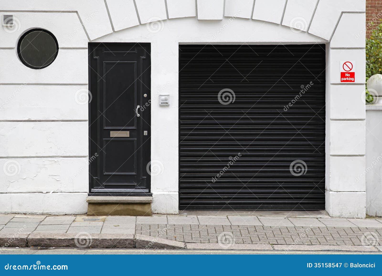 Grey house black garage doors - 9573919194937201300 Black Garage And Entrance Door At White House Bf0c0c Black Door White House 1300957