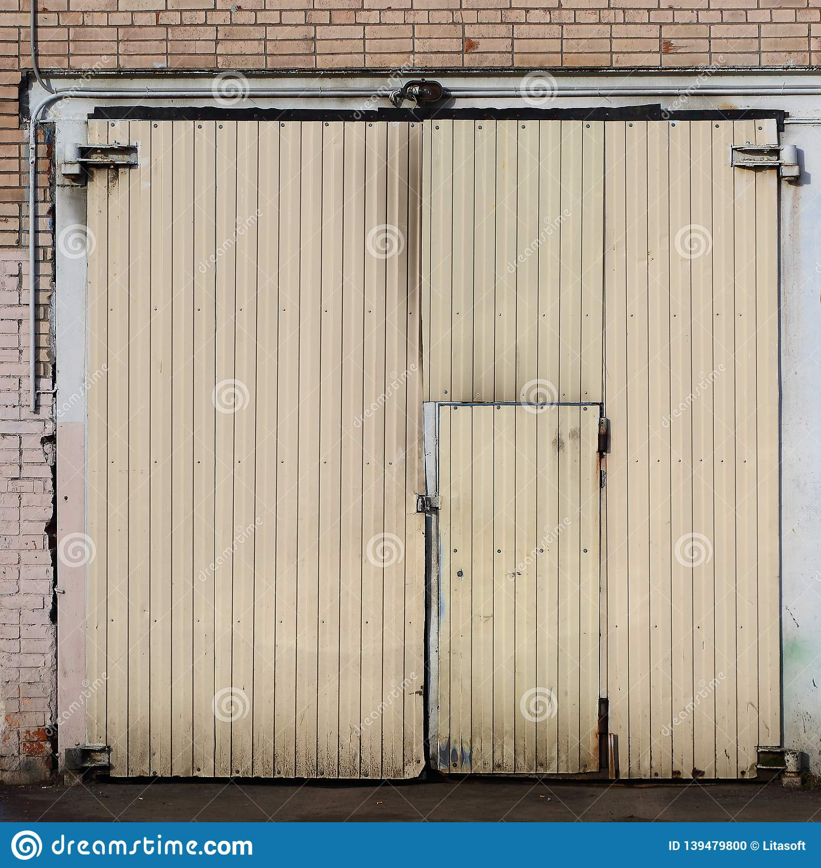 A Garage Door Made Of Light Corrugated Sheet Metal