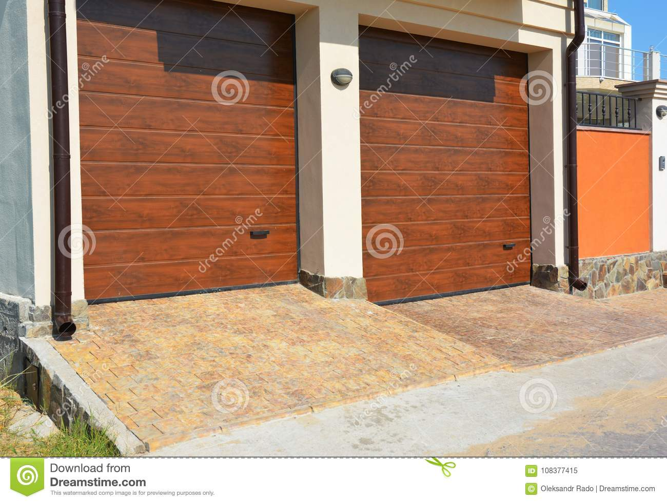 Garage Door For Two Cars With Pathway Pavement And Plastic Gutter