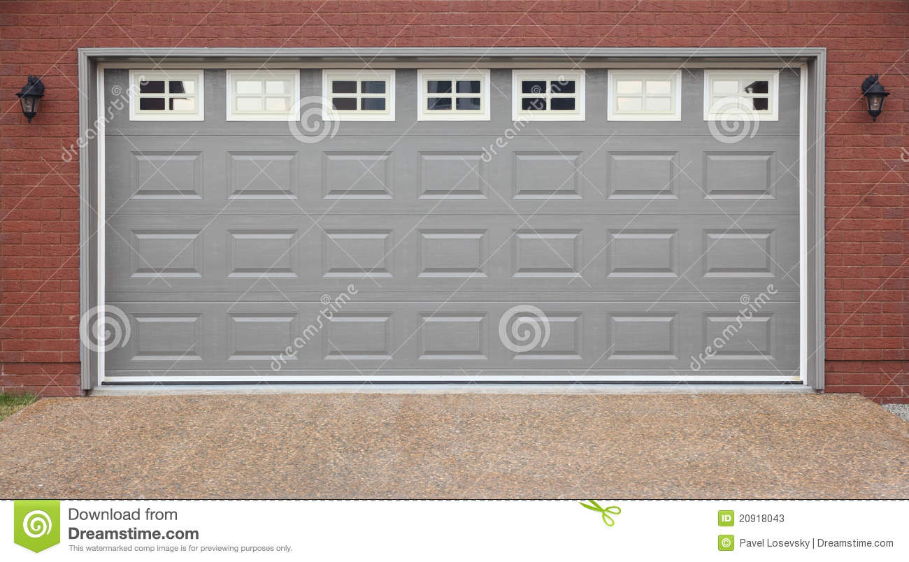 Garage with doors brick wall and asphalt driveway stock for Brick garages prices