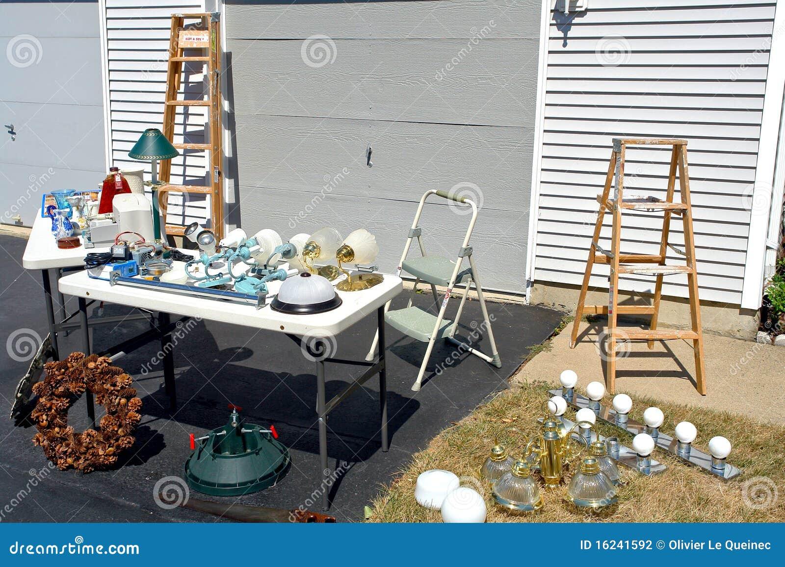 Garage Sale in Suburban House Driveway and Yard