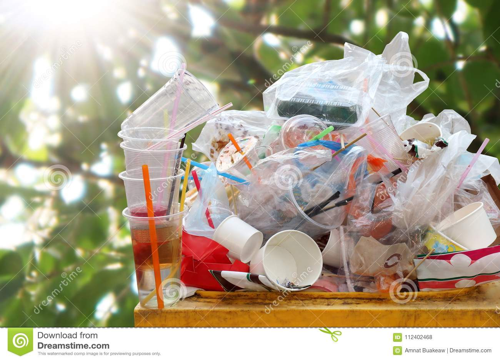 Garbage many close-up on Trash full of trash bin, Plastic bag waste Lots of junk on nature tree sunshine background