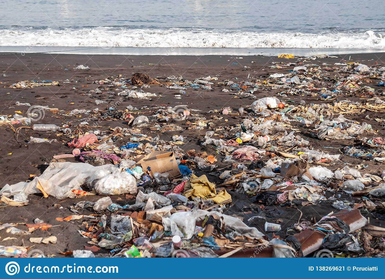 Garbage on a sandy polluted beach