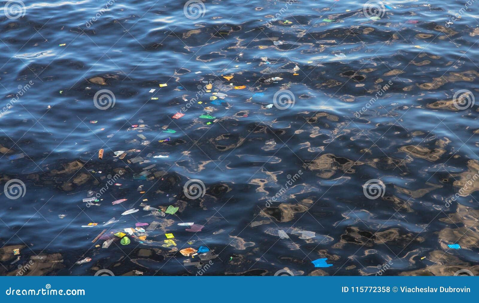 Garbage in sea water. Plastic trash in ocean. Ecological problem. Urban seaside pollution