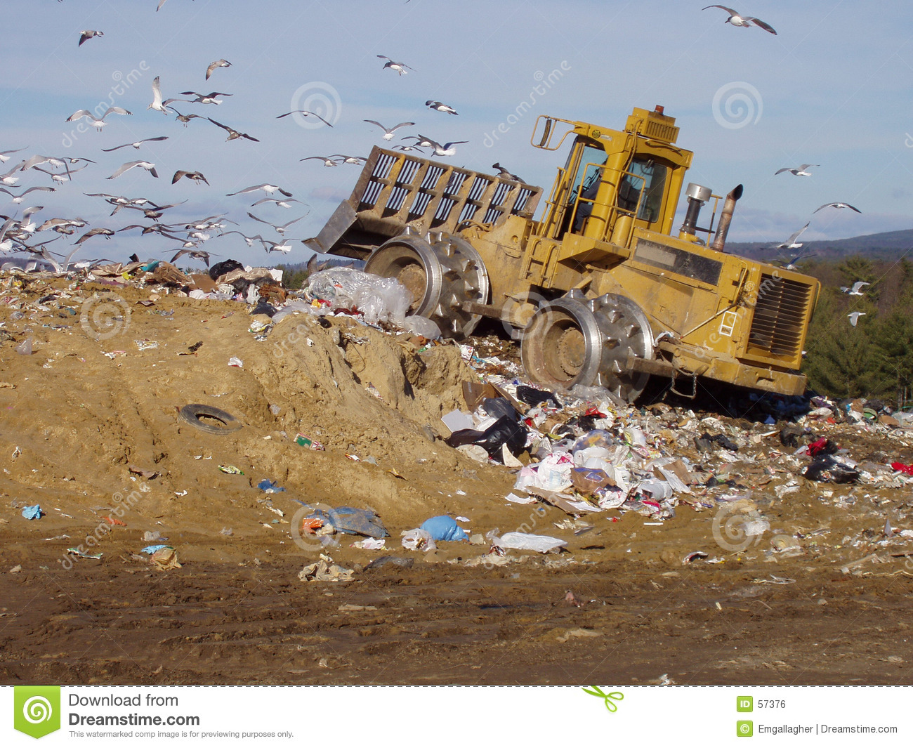 Landfills With Tractors : Landfill and tractor in desert stock photography