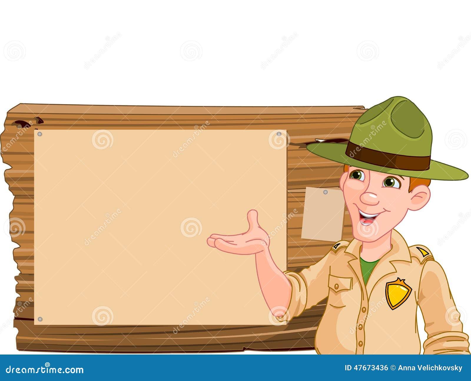Garde forestière se dirigeant à un signe en bois
