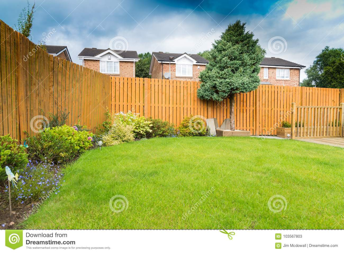 Garden Border With Fencing And Shrubs Stock Image Image Of