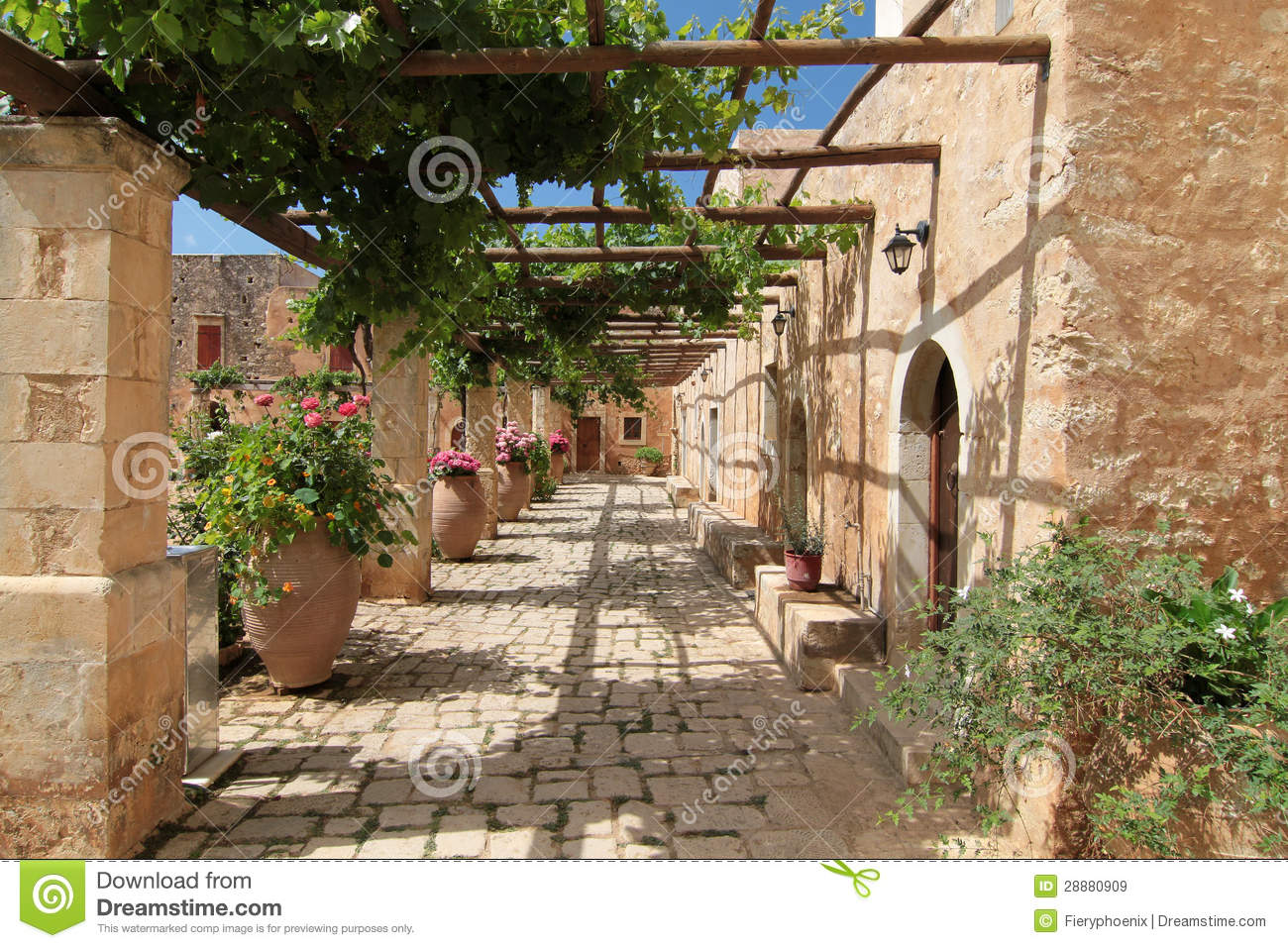 Garden Courtyard With Flowers In Ceramic Pots Royalty Free