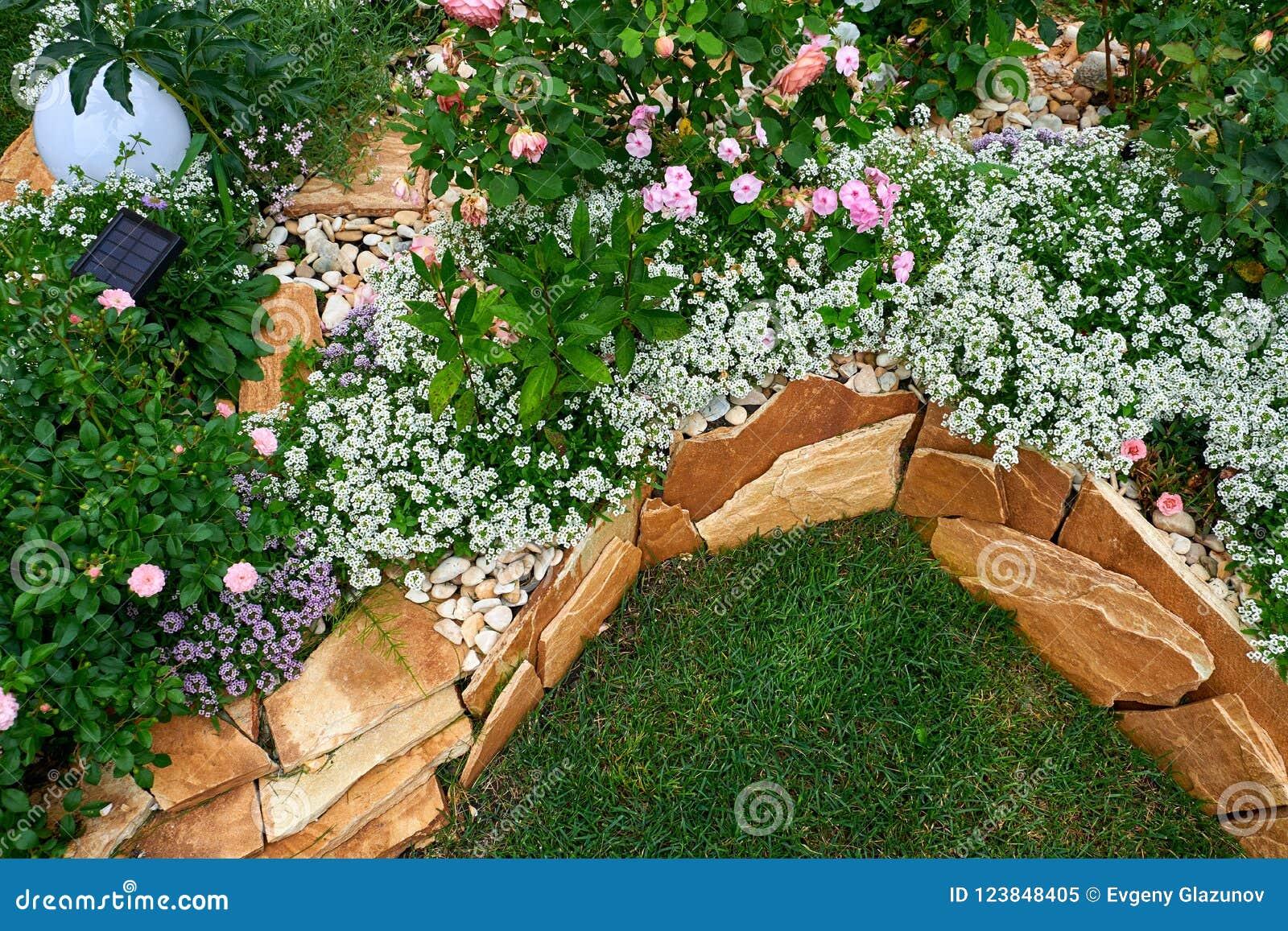 Garden Design. Flowerbed In The Yard In Landscape Design ... on natural water fountain design, natural building design, natural walkways, natural bird house design, leather bed design, natural landscaping design, natural wood design,