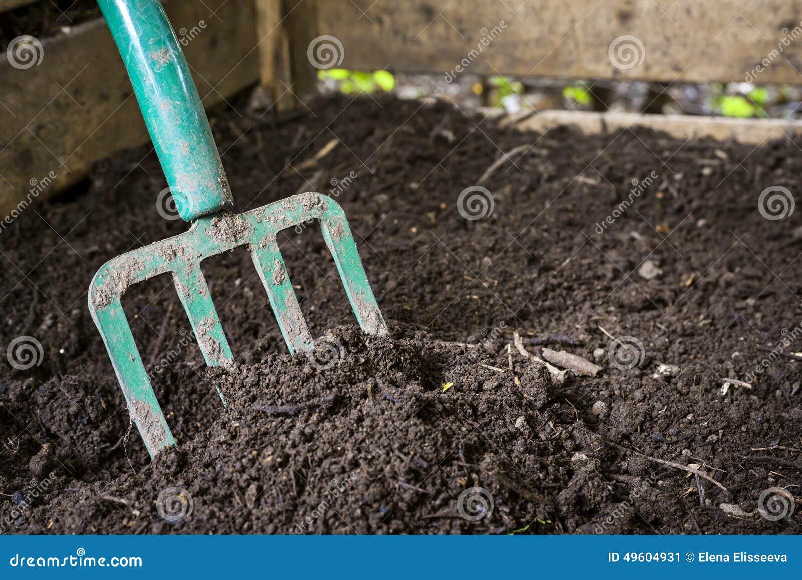 Garden fork turning compost stock image image 49604931 for Black garden soil