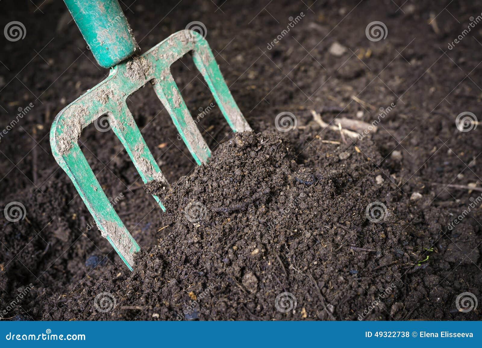 Garden fork turning composted soil stock photo image for Black garden soil