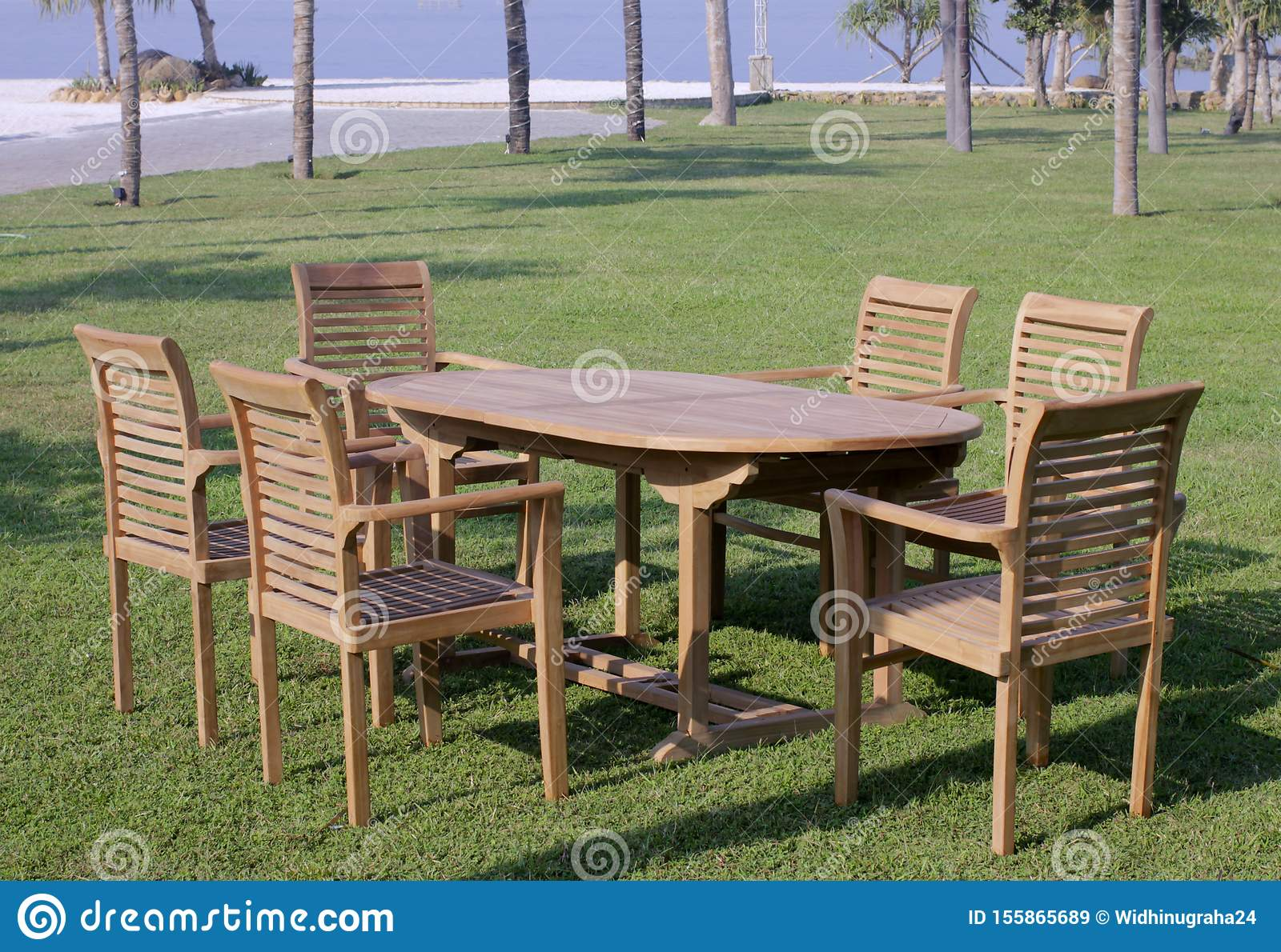 Picture of: Garden Furniture Outdoor Teak Dining Table Chairs Stock Image Image Of Minimalisfurniture Furniture 155865689