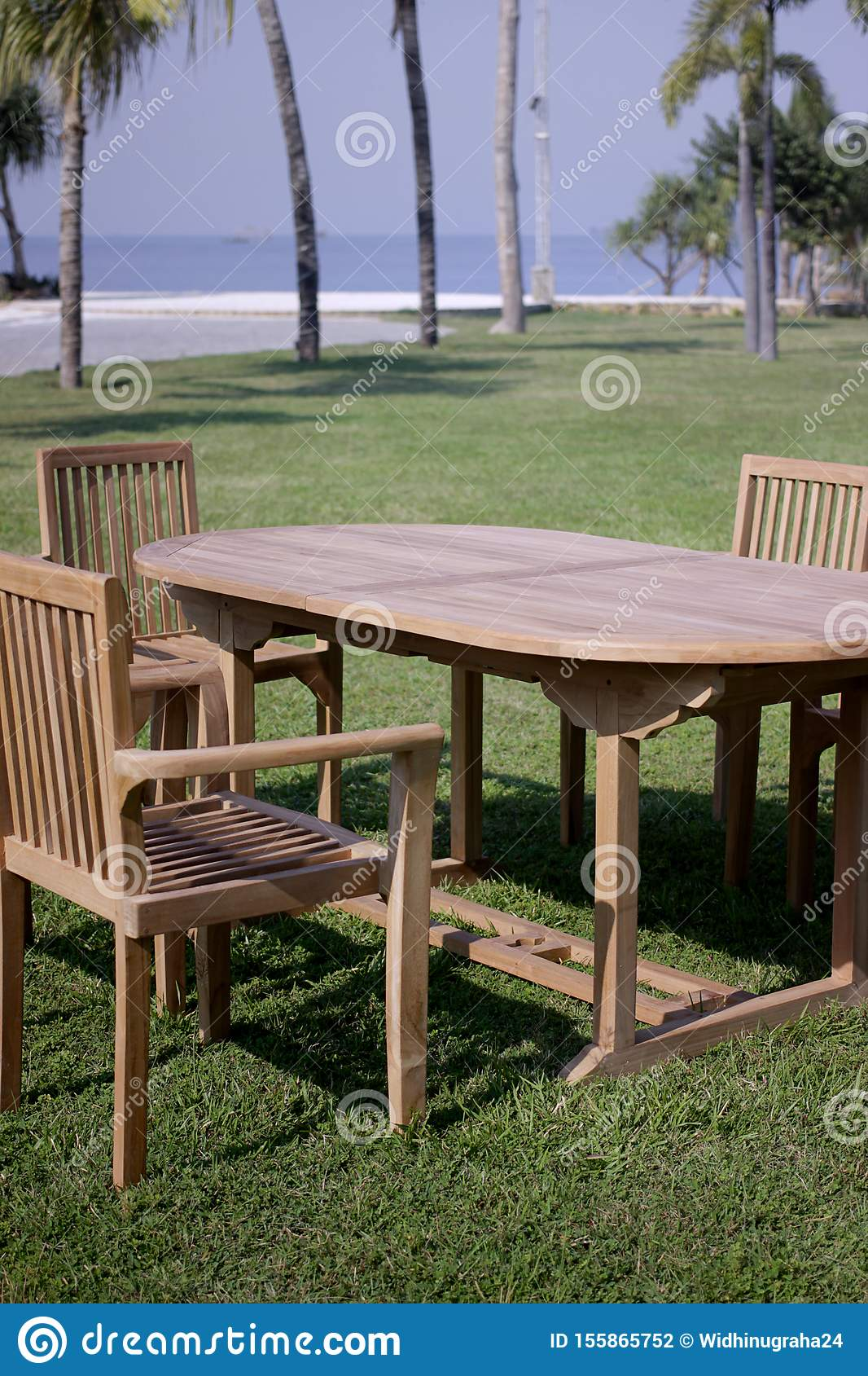 Picture of: Garden Furniture Outdoor Teak Dining Table Chairs Stock Photo Image Of Table Furniture 155865752