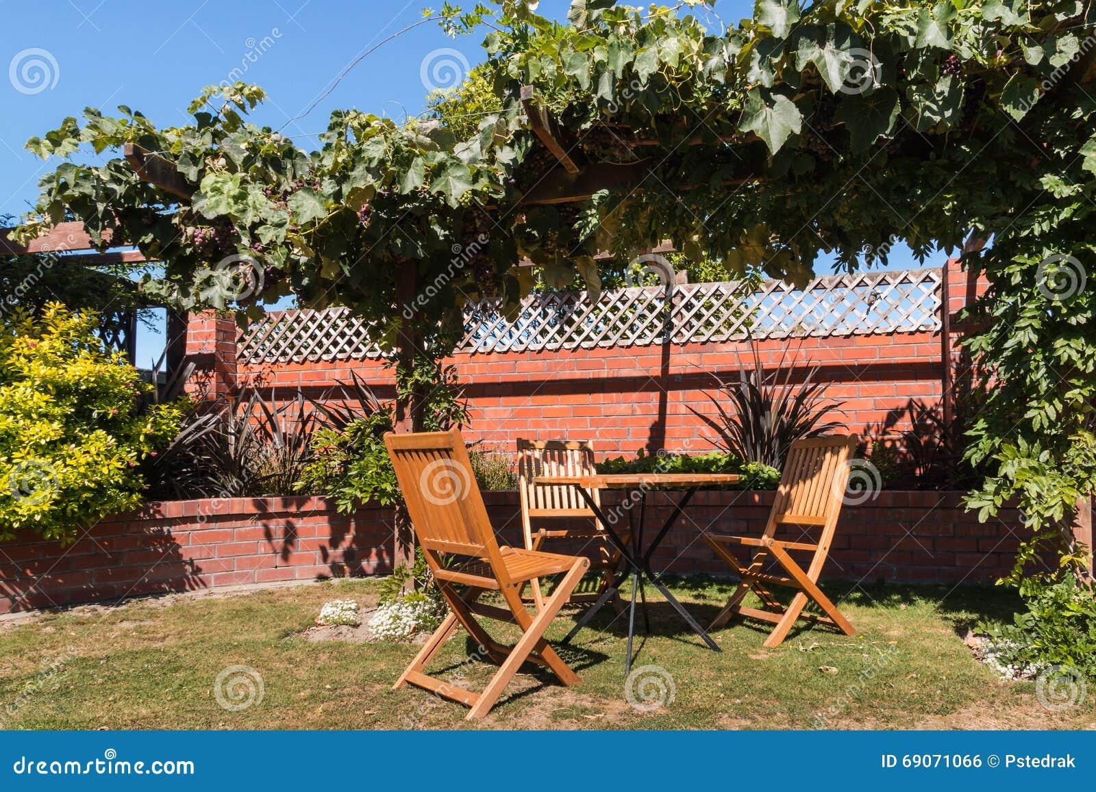 Ordinaire Download Garden Furniture Under Grapevine Pergola Stock Photo   Image Of  Table, Grapevine: 69071066