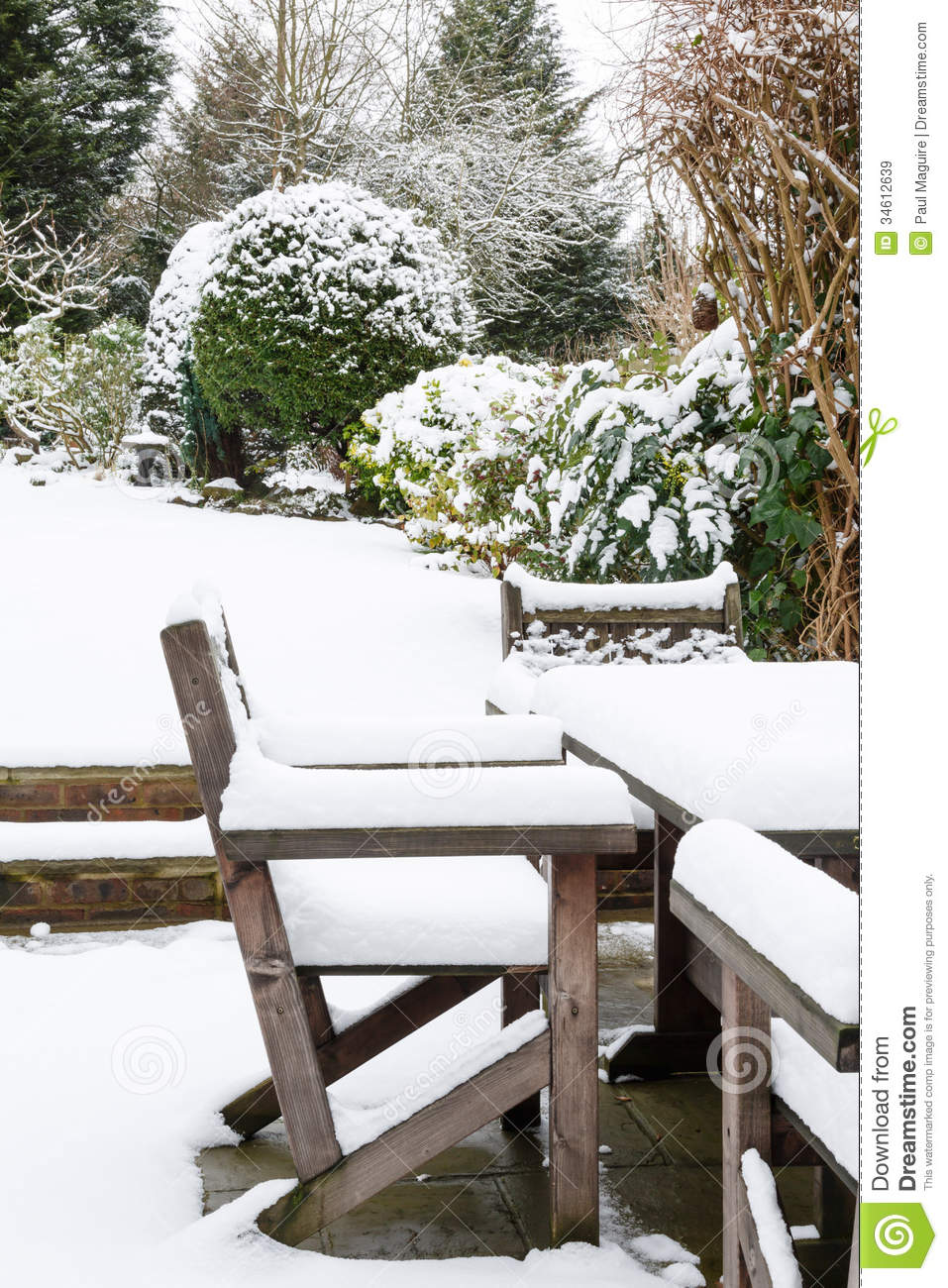 Garden Furniture Under Snow Royalty Free Stock Images