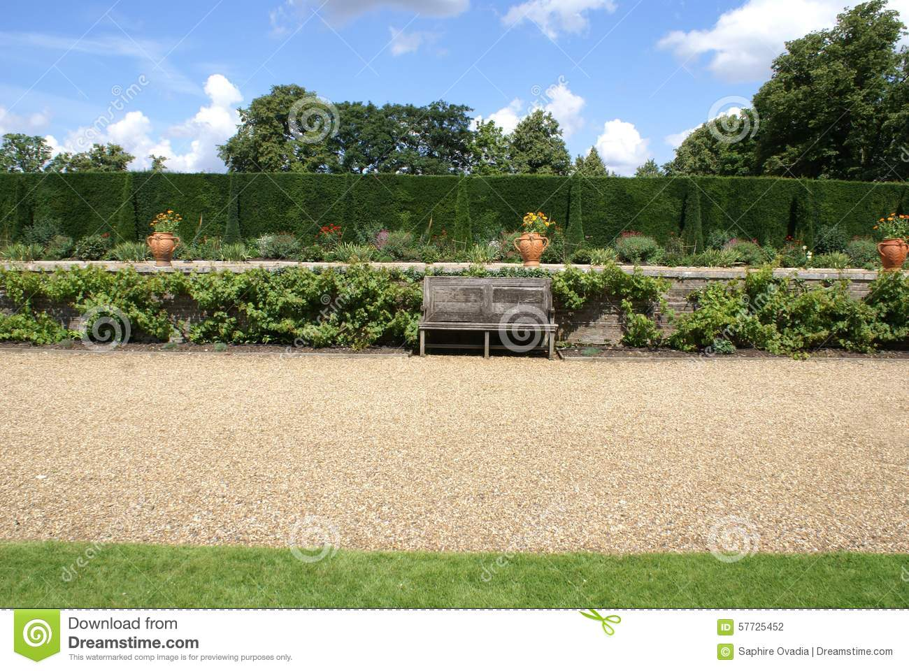 Garden Gravel Path With A Wooden Bench And Vases Stock ...