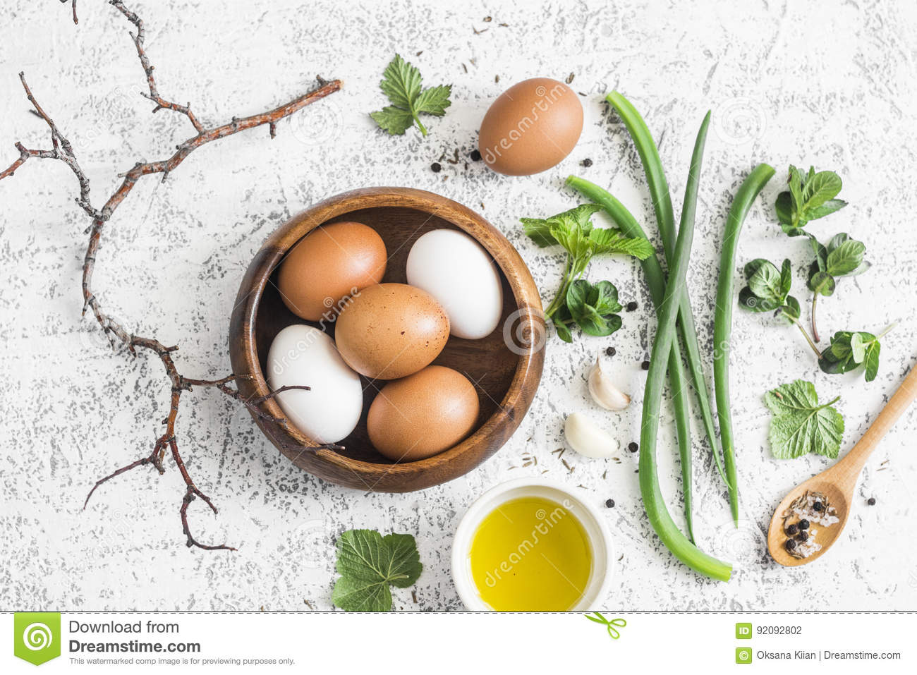 Garden herbs, spices and eggs rustic kitchen still life.On a light table, top view. Flat lay. Ingredients for cooking omelet with
