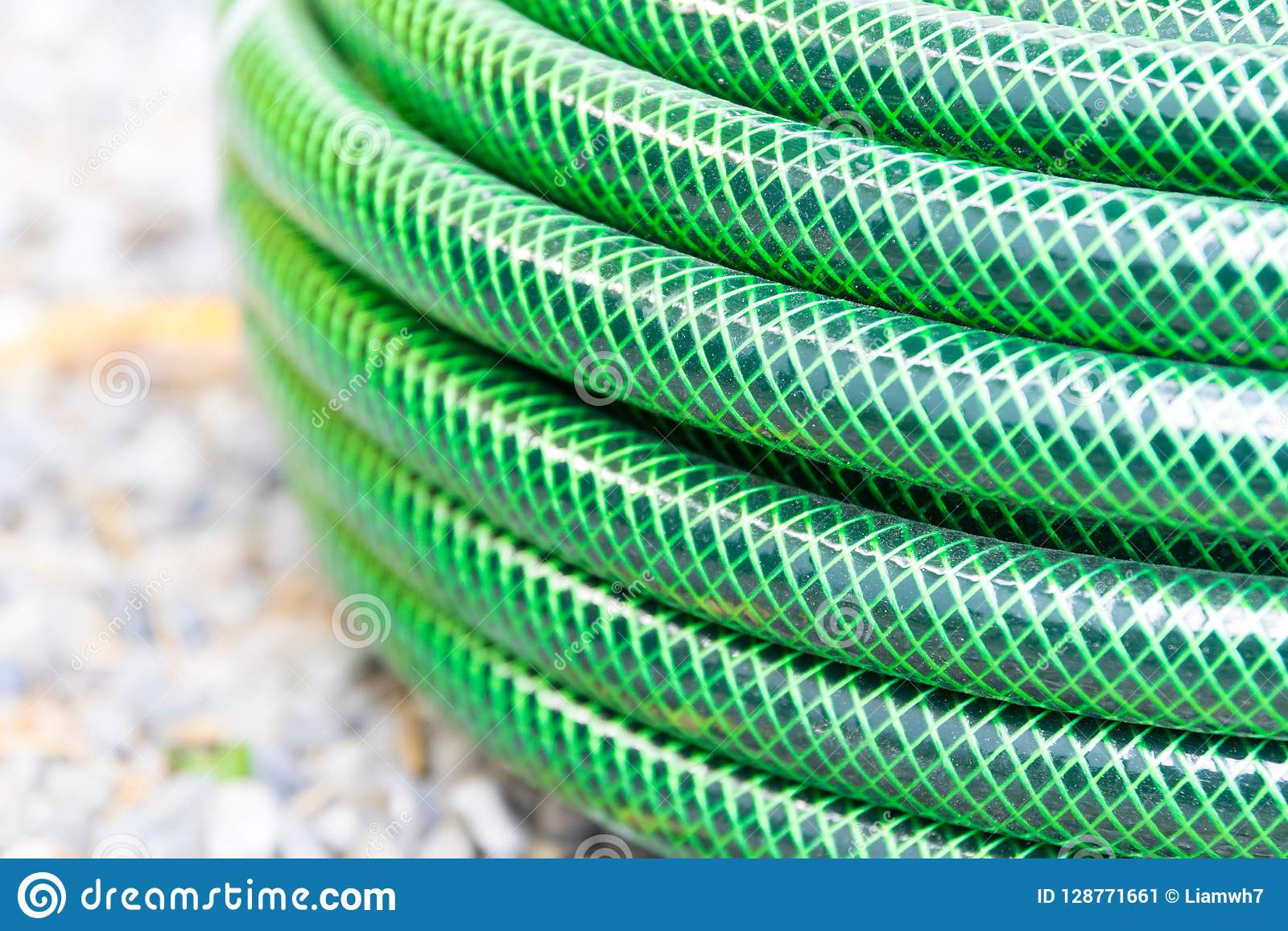 Garden hose pipe green water close up
