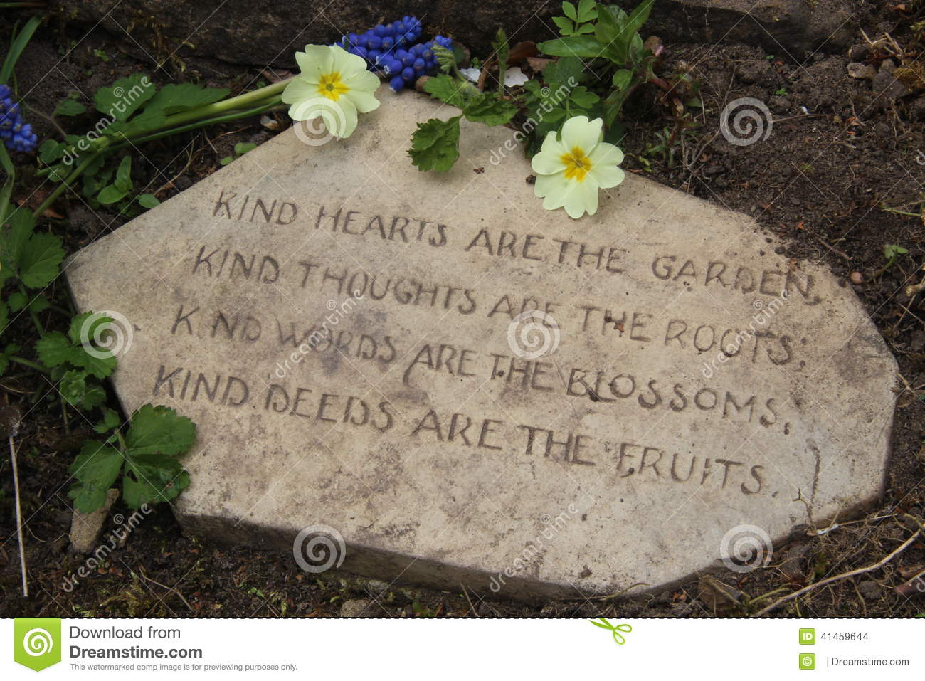 Garden Poem On Stone With Primroses Kindness Concept Stock