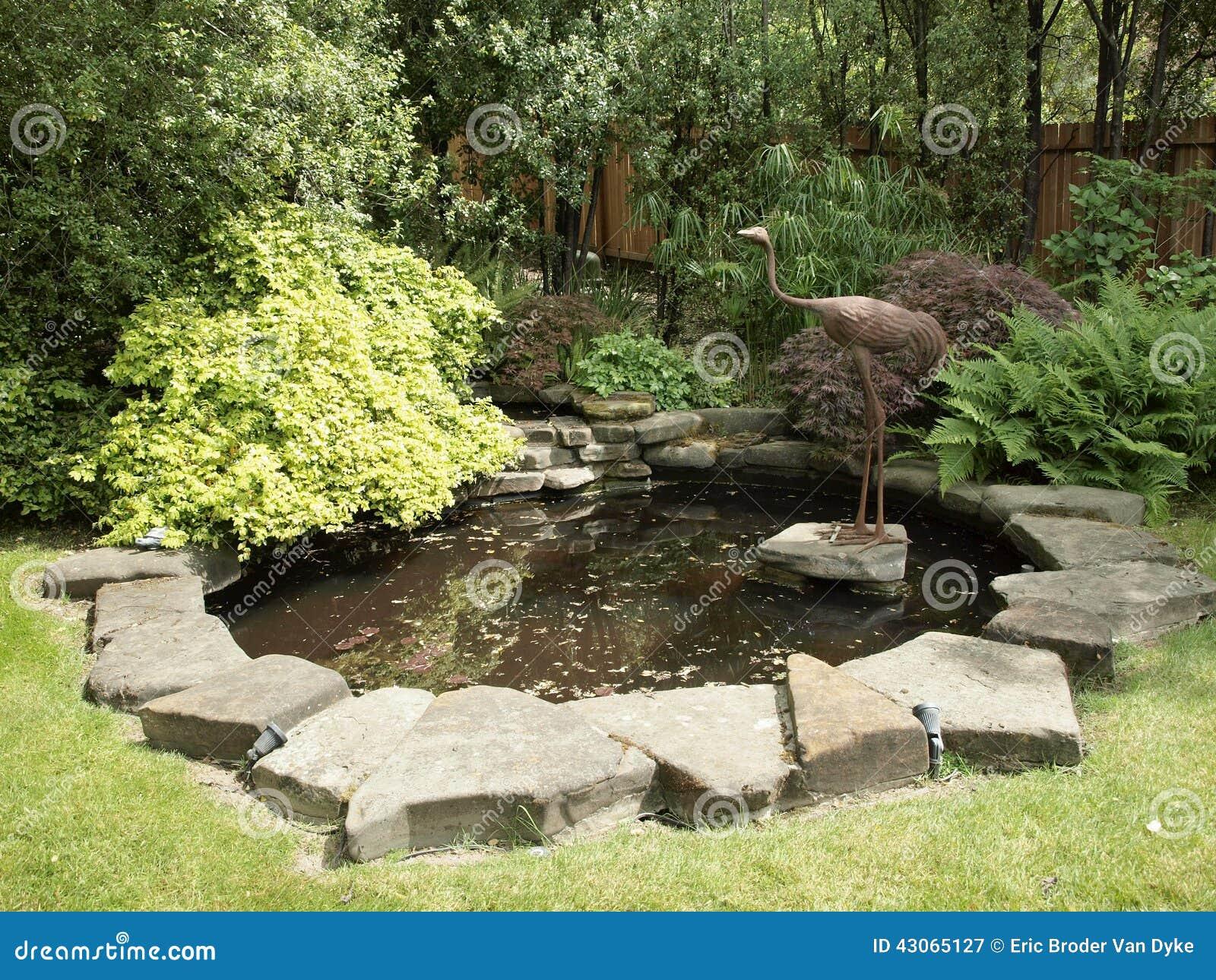 Stsatuette For Outdoor Ponds: Garden Pond With Bird Crane Bronze Statue Stock Image