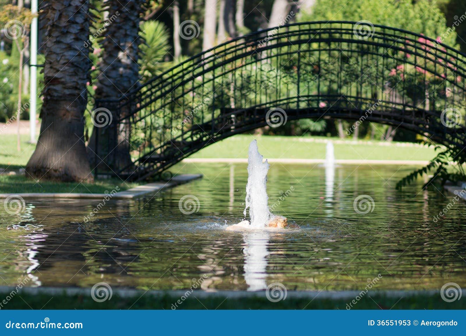 Garden with pond and bridge stock image image of for Garden pond bridge