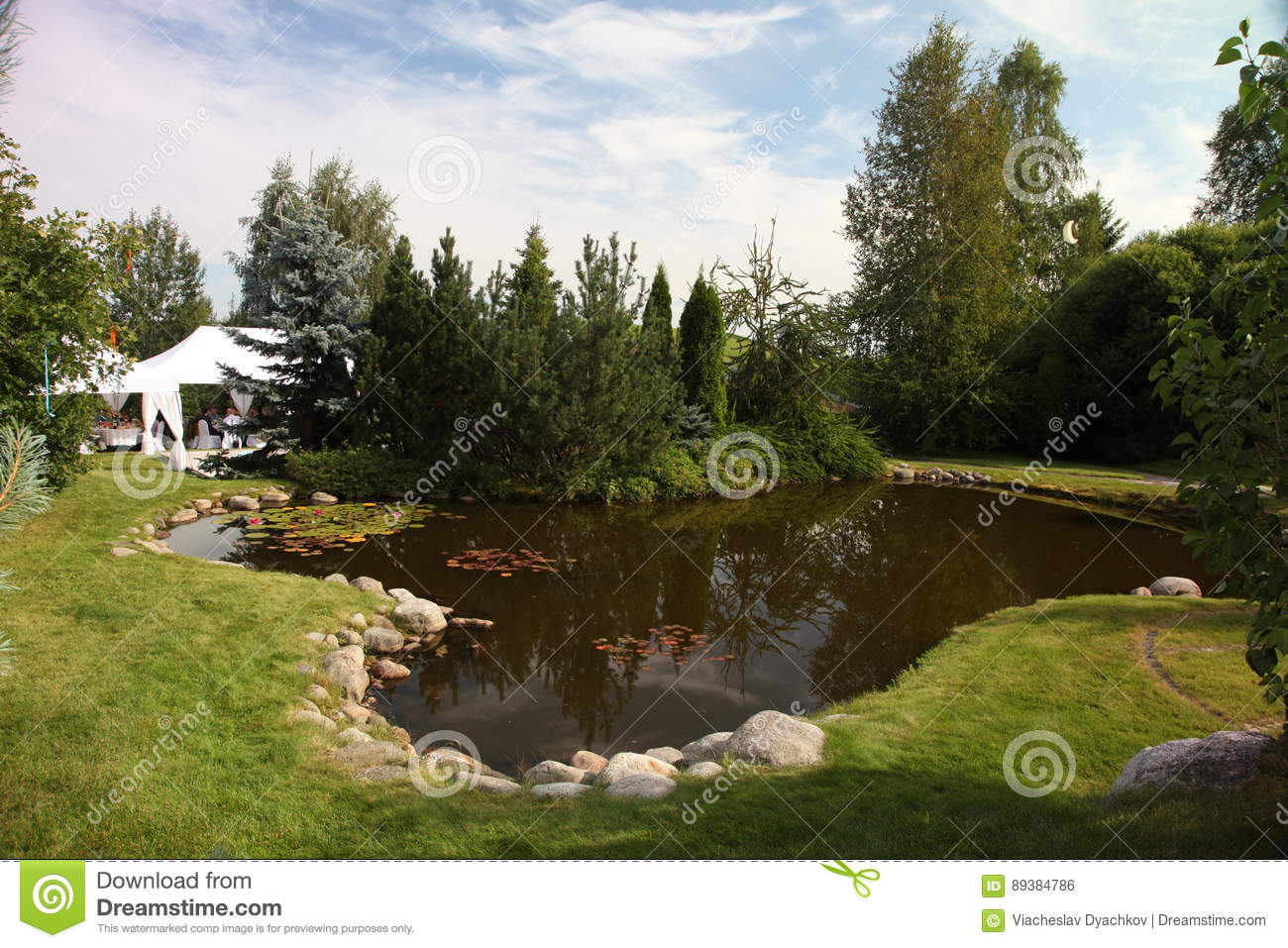 Garden Pond In Front Of The House. Pond In A Yard Of A Big Cottage ...