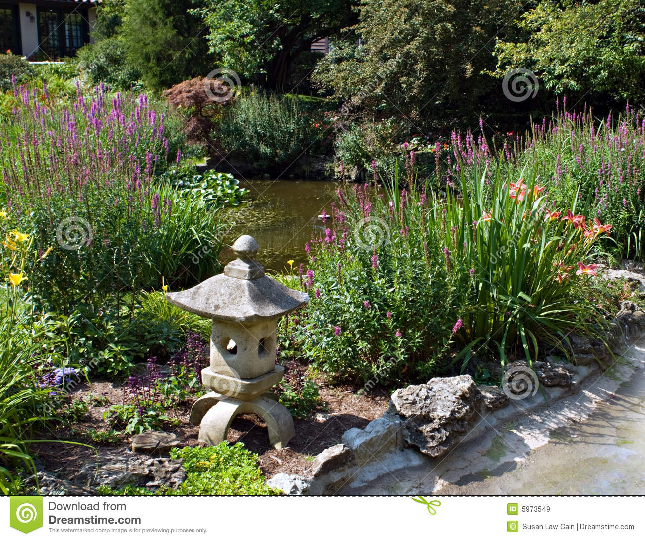 Garden pond with sculpture royalty free stock images for Setting up a garden pond