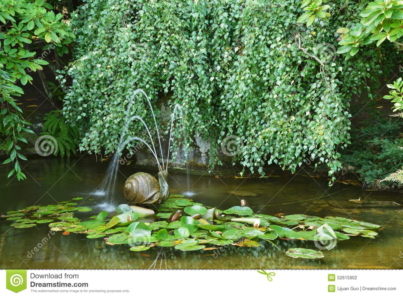 Garden pond with a snail fountain stock photo image for Garden pond snails