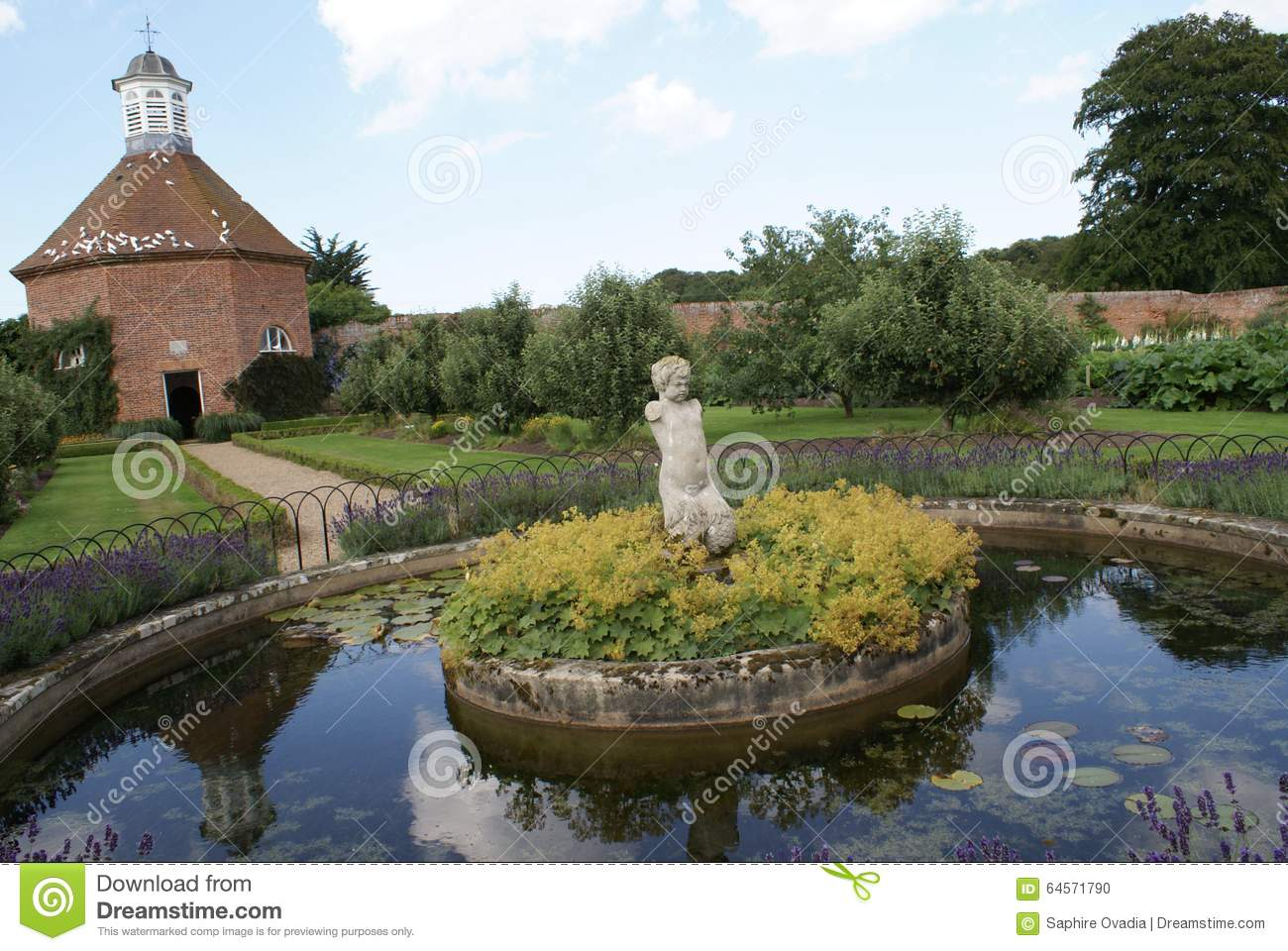Stsatuette For Outdoor Ponds: Garden Stock Photo