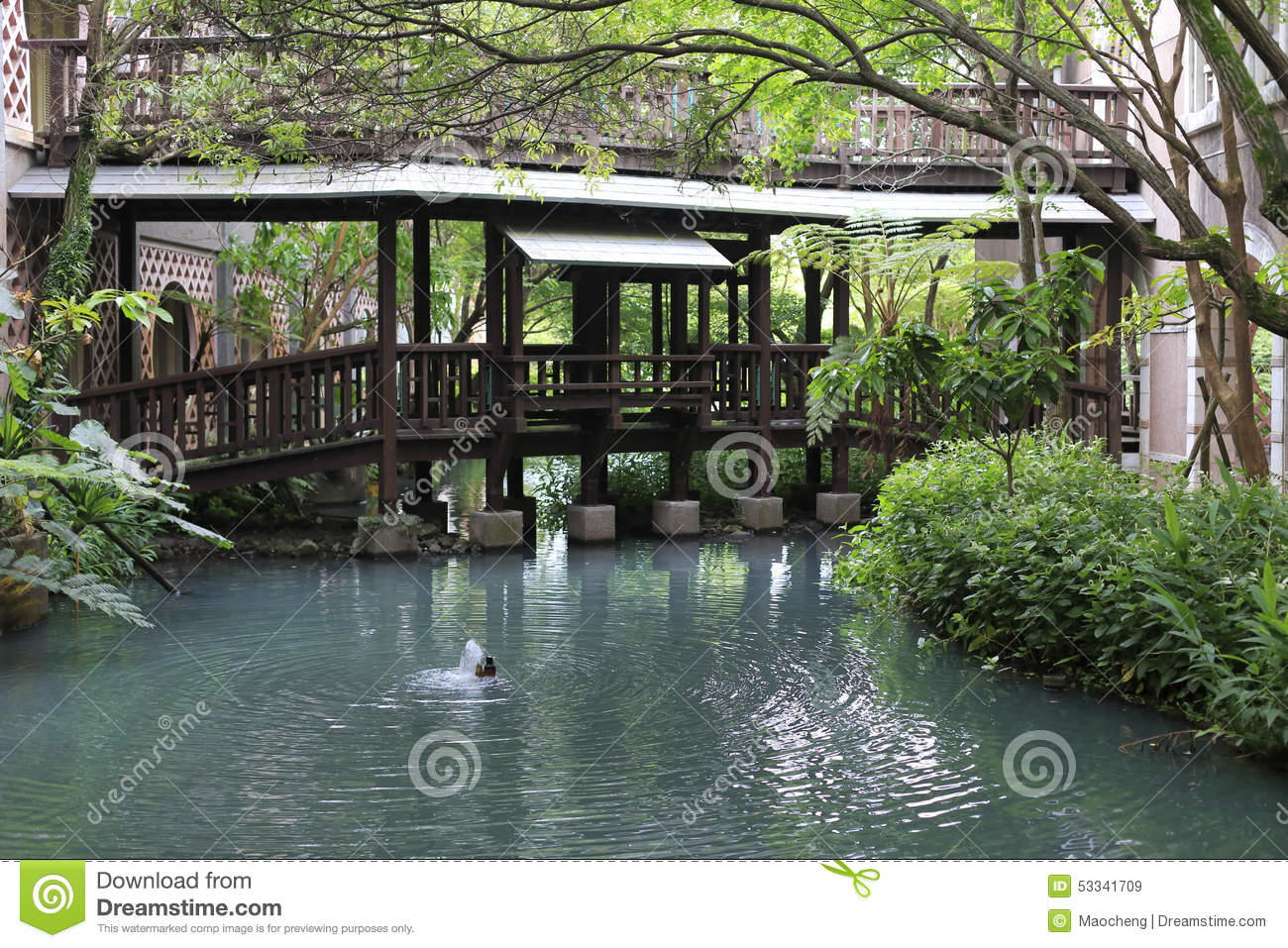 Garden with pool and covered bridge stock photo image for Garden treasures pool clock