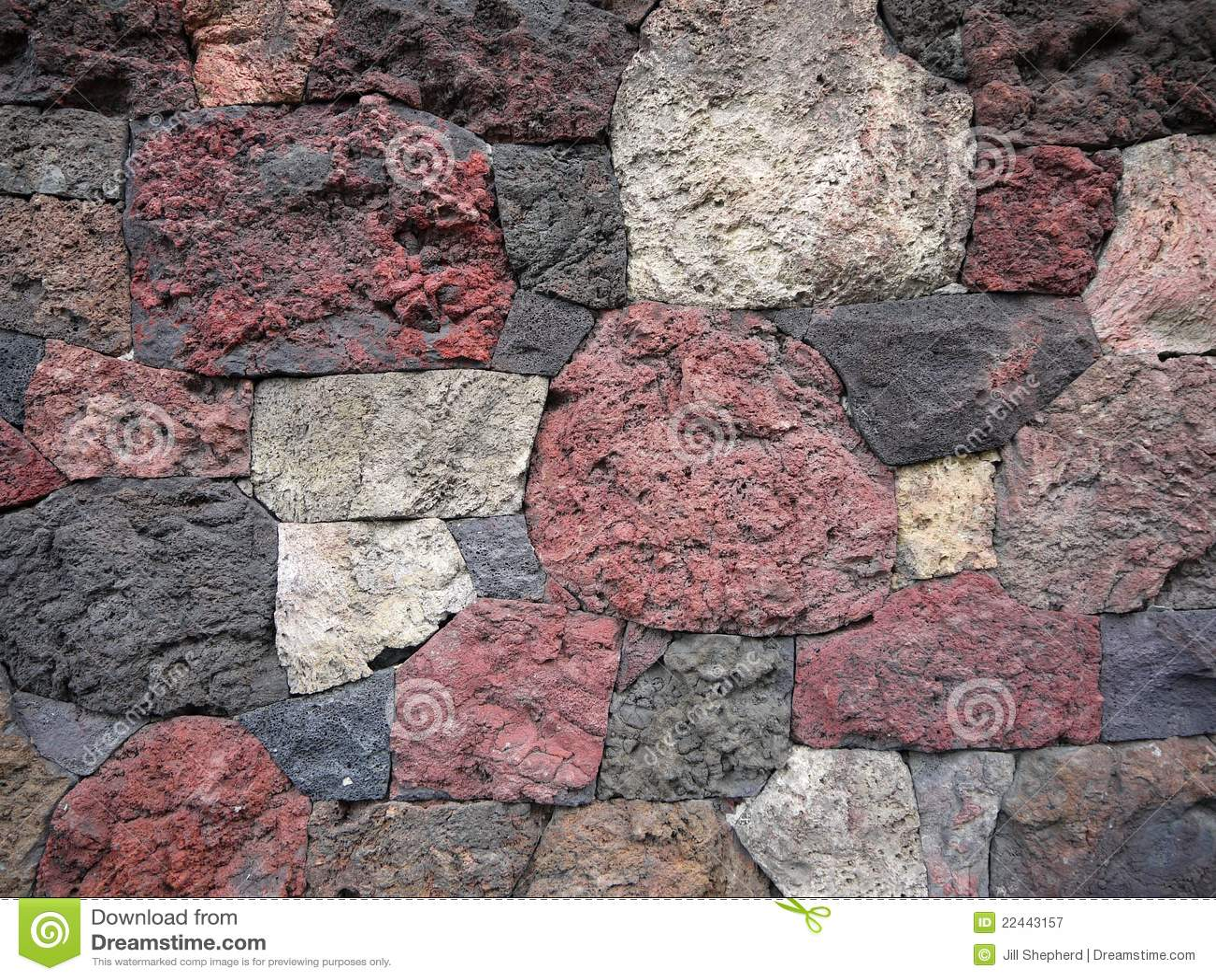 Garden scoria lava rock wall royalty free stock for Landscaping rocks auckland