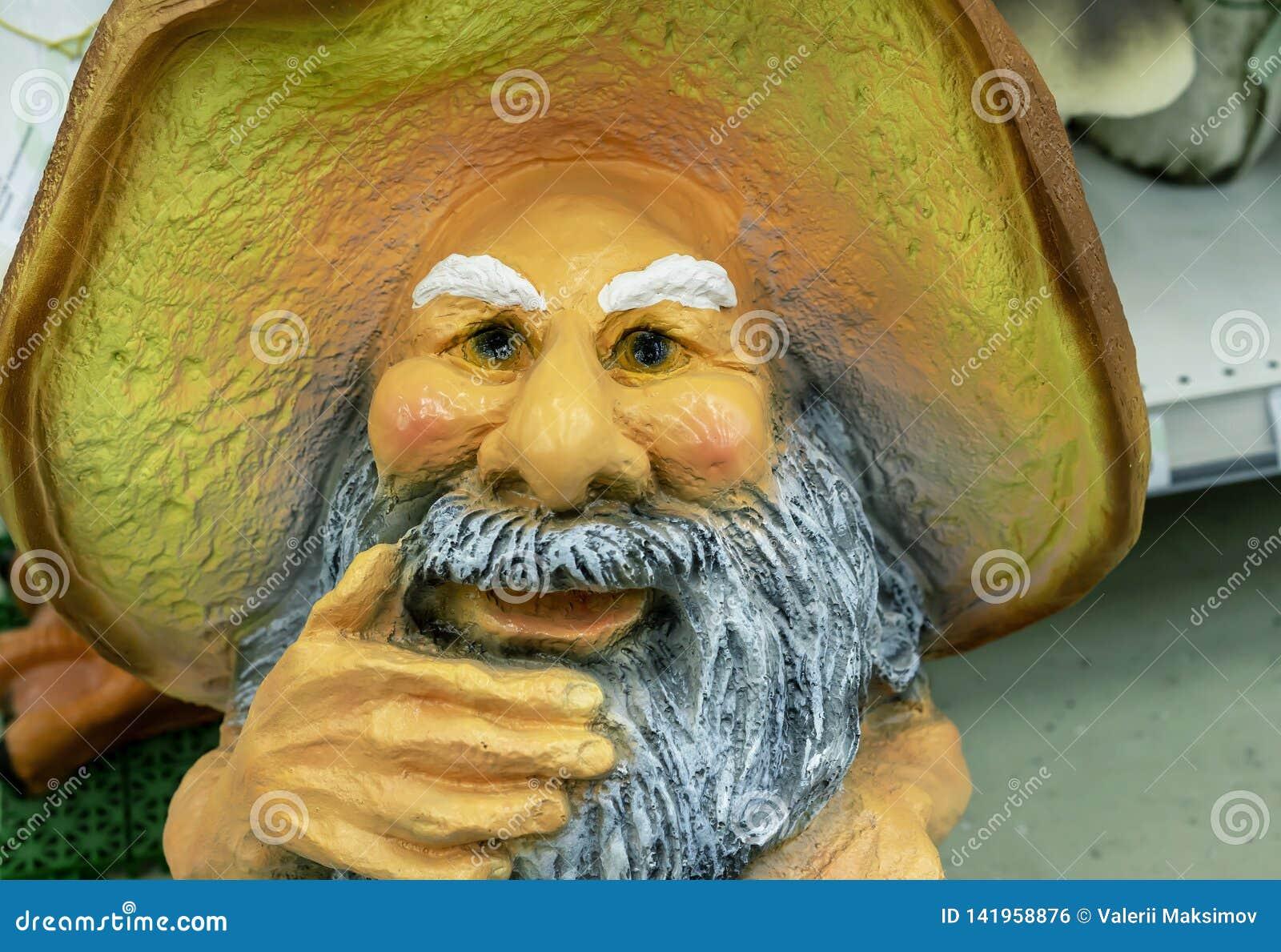 Garden sculpture of mushroom grandfather from Russian folk tales