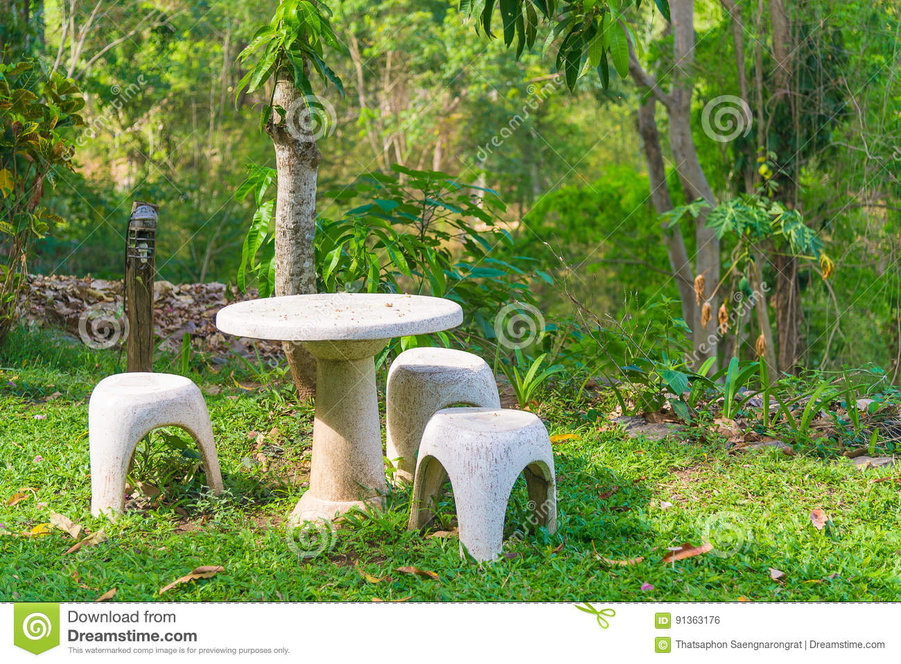 Garden Seat Of Stone Or Stone Table And Benches In The Garden. Stock Photo