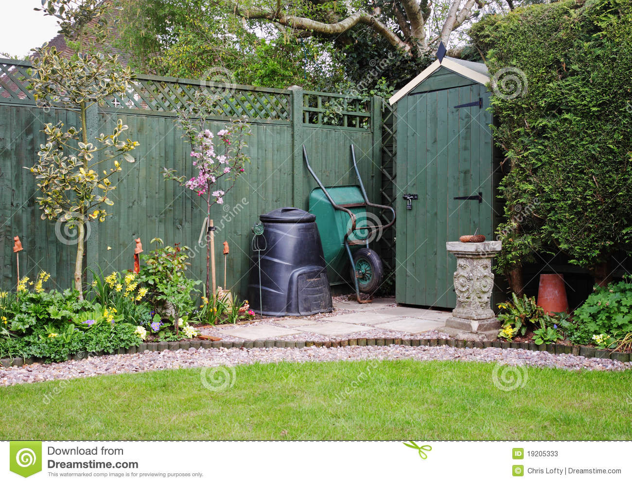 Garden shed in an english garden with compost bin stock for Compost tuin