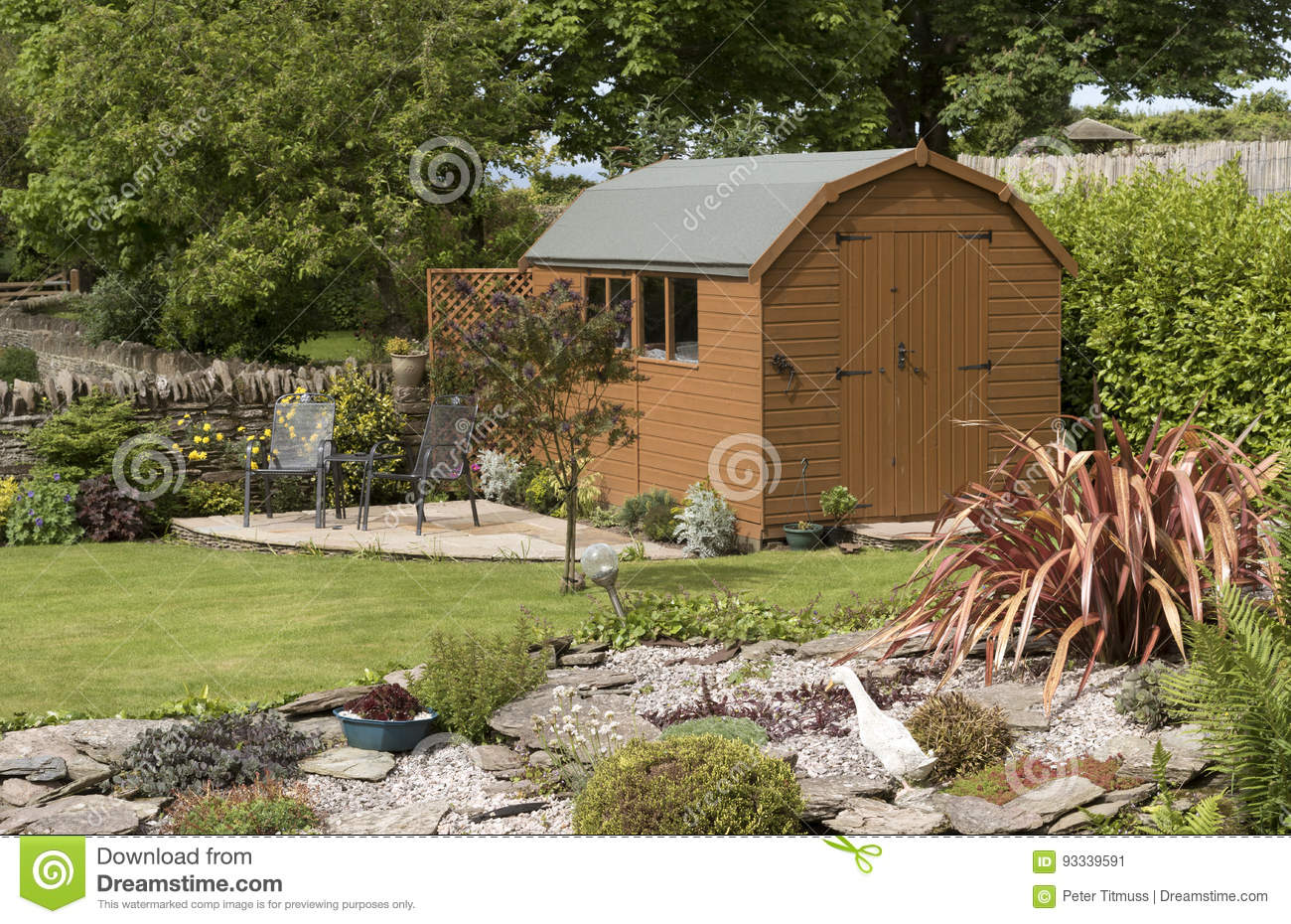 Garden Shed And Patio With Seating Set In A Lovely Garden Stock ...