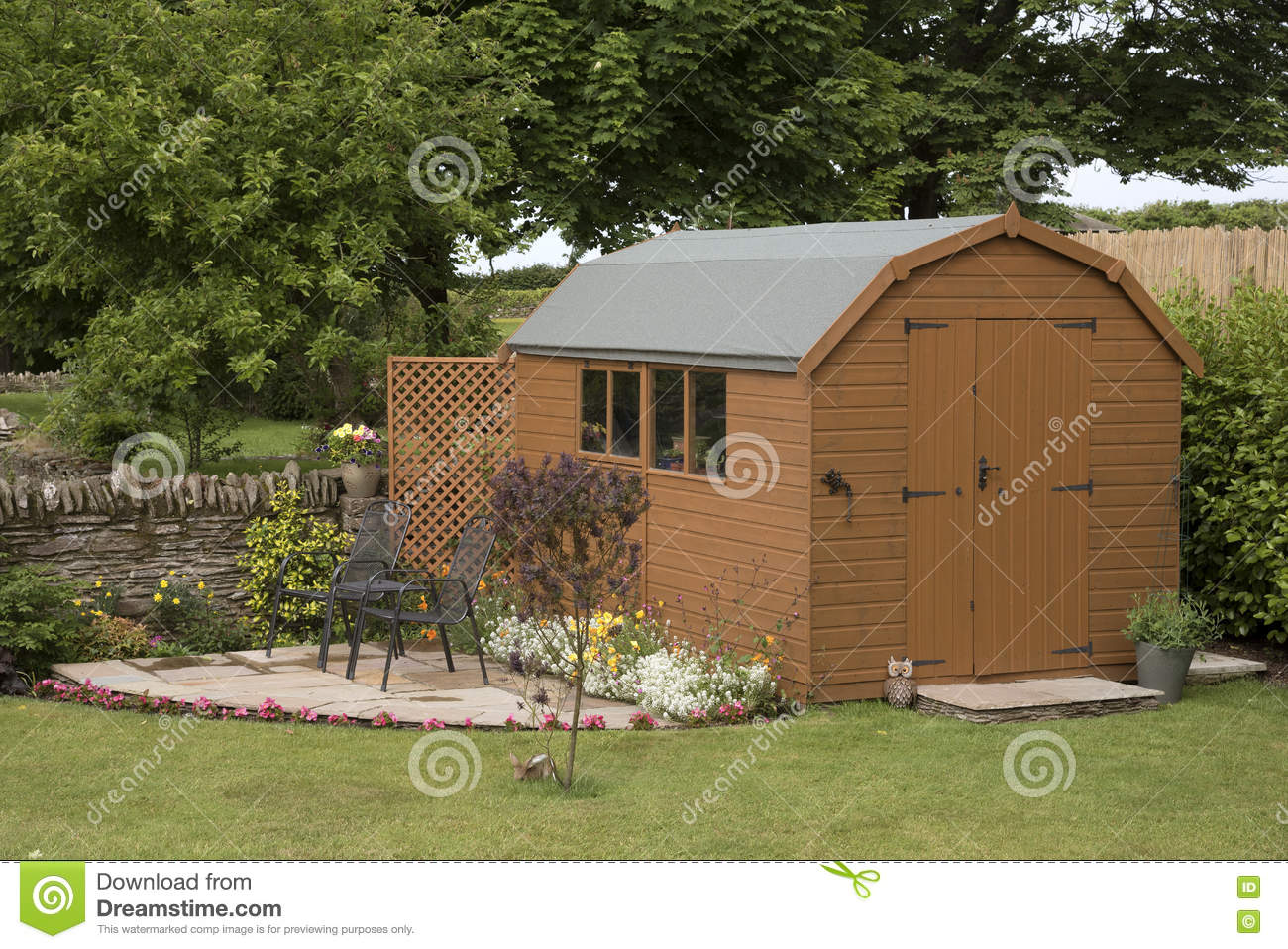 A Garden Shed And Small Patio Stock Photo - Image of plants, double ...