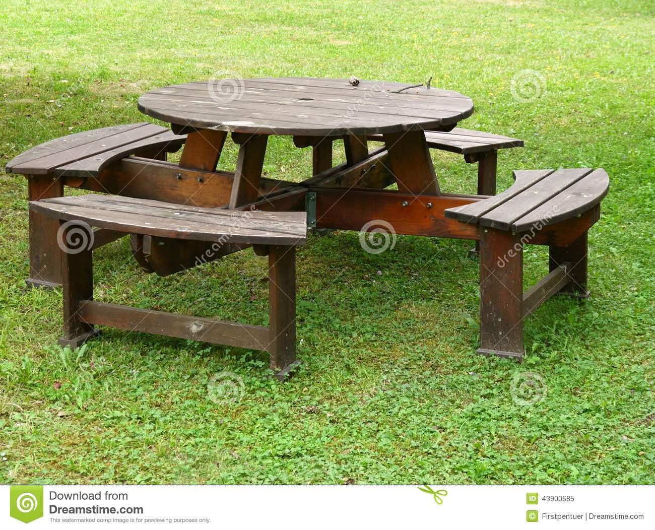 Garden Table With Benches In Middle Of Grass Stock Image